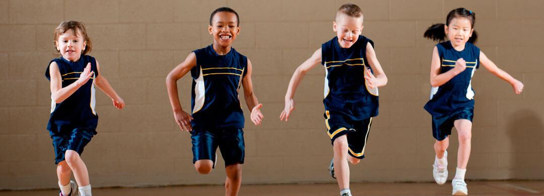 Kids running in a school gymnasium
