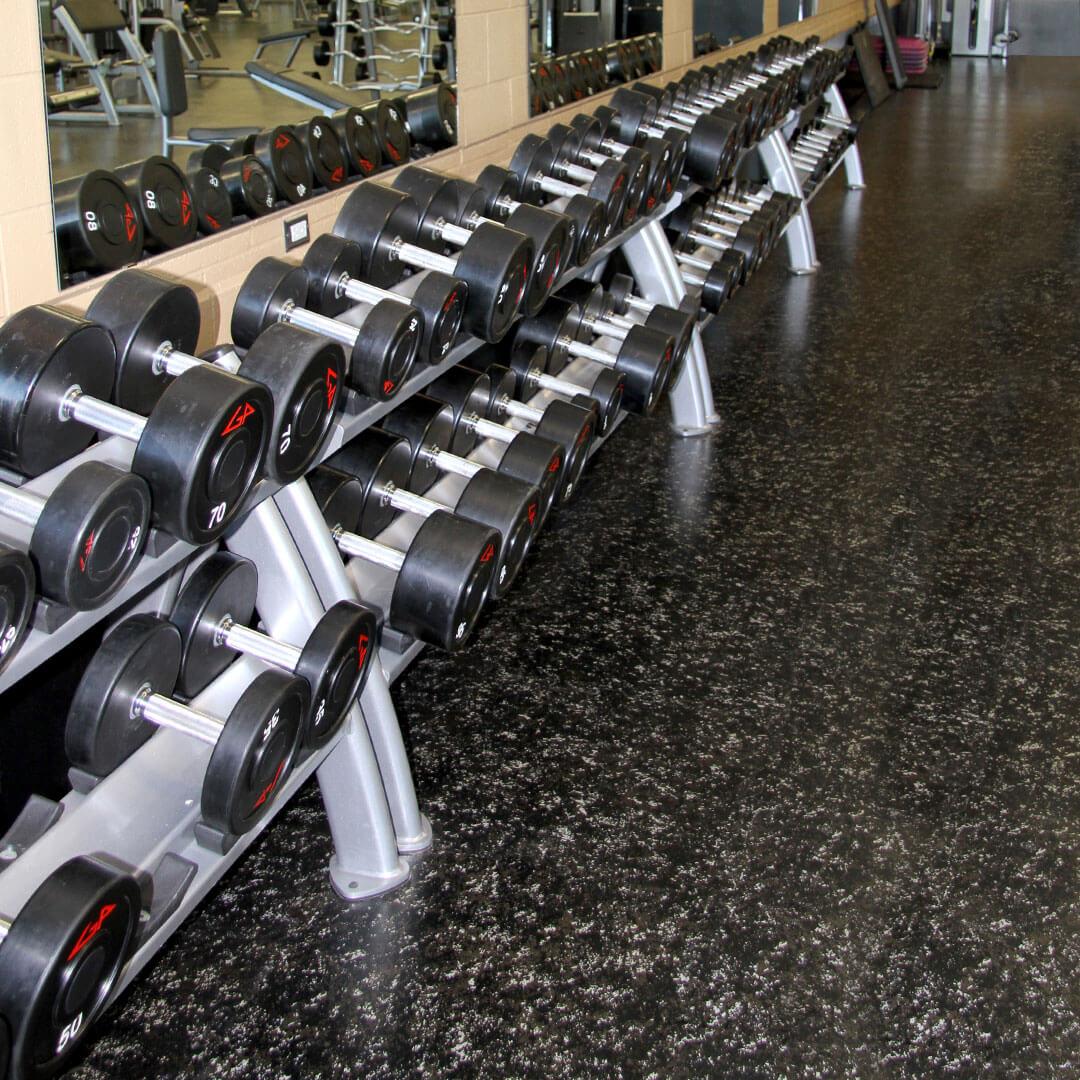 Interlocking rubber flooring in free weight gym area