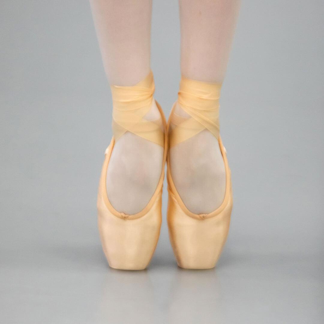 Ballet shoes on dance floor